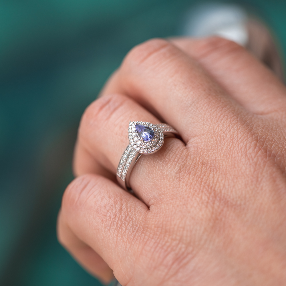 Tanzanite & Diamond halo ring in 9ct white Gold