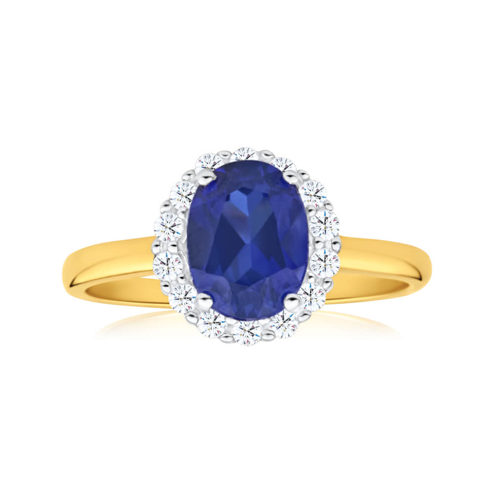 9ct Yellow Gold 8x6mm Oval Created Sapphire and Cubic Zirconia Halo Ring