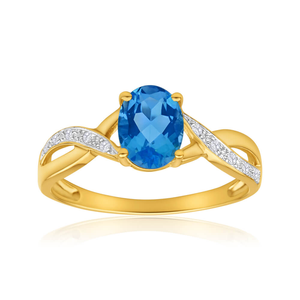 9ct Yellow Gold Blue Topaz and Diamond Cross Over Ring