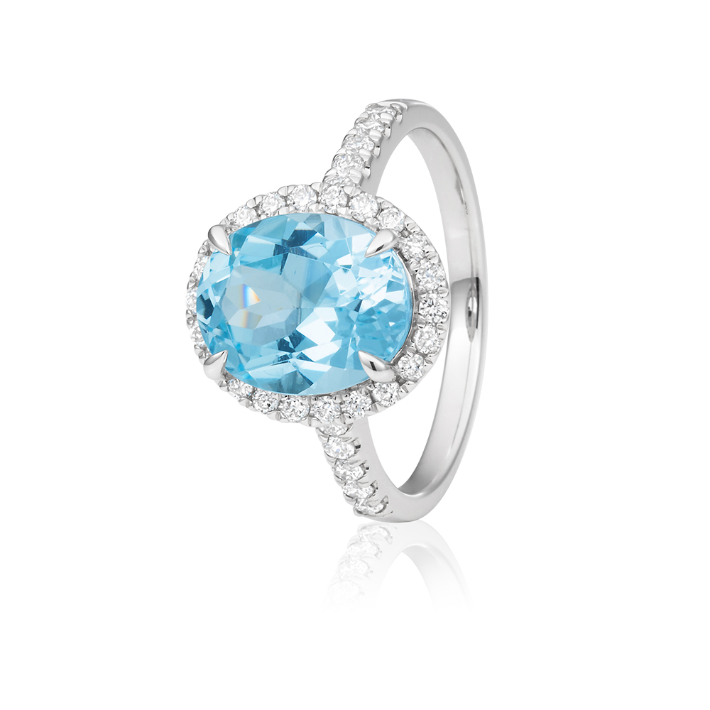 9ct White Gold Light Blue Topaz Ring 10x8mm Oval with 0.34ct Diamonds