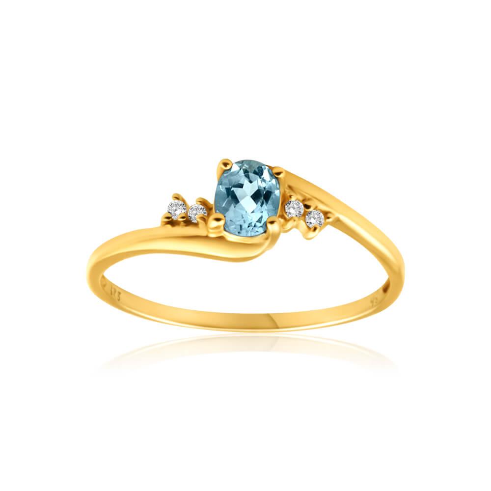 9ct Yellow Gold Blue Topaz + 4 Cubic Zirconia Ring